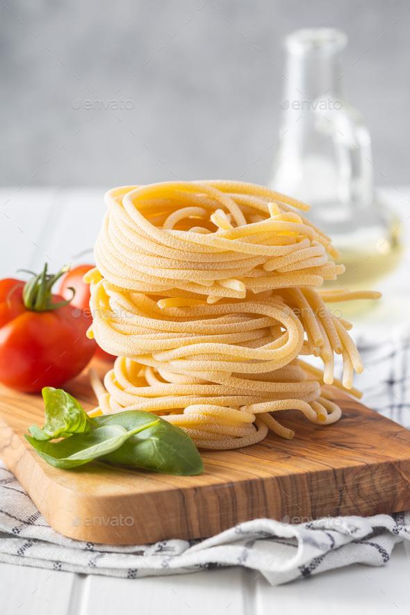 Italian pasta nest. Uncooked spaghetti nest. - Stock Photo - Images