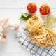 Italian pasta nest, basil, garlic and tomato. Uncooked spaghetti nest - PhotoDune Item for Sale