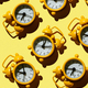 Yellow Alarm Clock on yellow background Pattern - PhotoDune Item for Sale