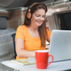 Caucasian senior woman working inside mini van camper with computer laptop - PhotoDune Item for Sale