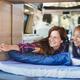 Mature multiracial women relax inside mini van camper - PhotoDune Item for Sale