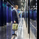 Man with backpack using cellphone waiting train at subway station platform going to work. - PhotoDune Item for Sale
