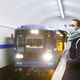 Man passenger wear face mask waiting train at subway station. Flu, covid in public transportation - PhotoDune Item for Sale
