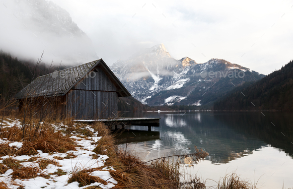 Boat shed in the mountain lake in Austria - Stock Photo - Images