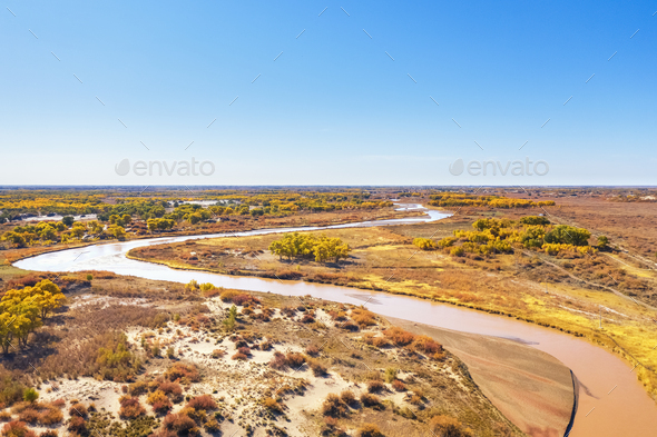 aerial view of the winding river and flood land in autumn - Stock Photo - Images