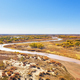 aerial view of the winding river and flood land in autumn - PhotoDune Item for Sale