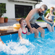 Father with three daughters outdoors in the backyard, playing in wimming pool - PhotoDune Item for Sale