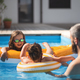 Father with three daughters outdoors in the backyard, playing in swimming pool - PhotoDune Item for Sale
