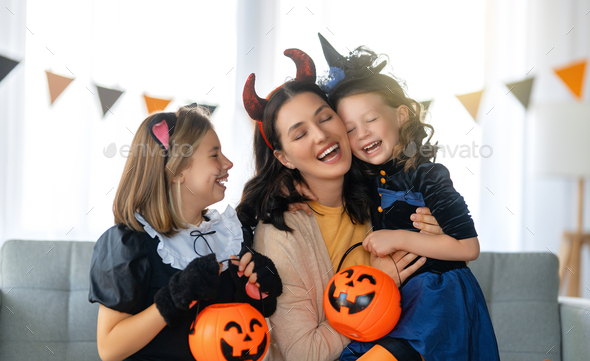 Happy family celebrating Halloween - Stock Photo - Images