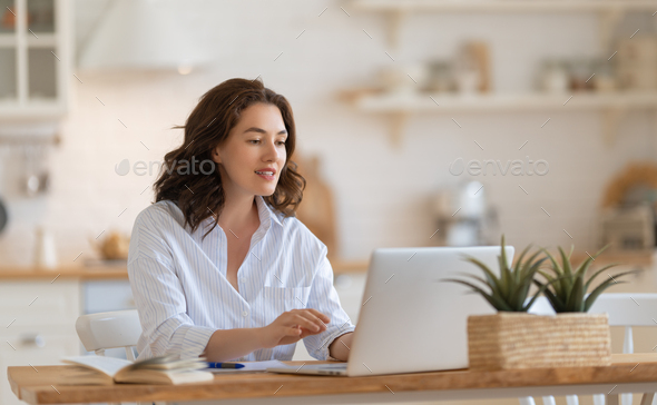 young woman working at home - Stock Photo - Images