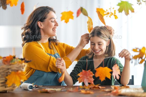 family doing autumn decor - Stock Photo - Images