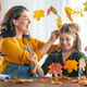 family doing autumn decor - PhotoDune Item for Sale
