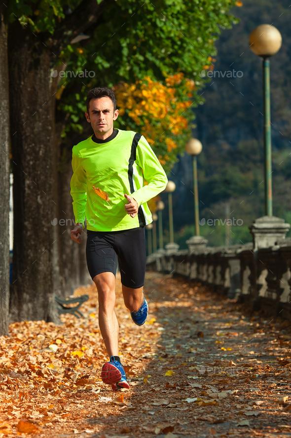 Athlete man runs - Stock Photo - Images