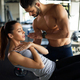 Personal trainer assisting woman to lose weight. Sport exercise people healthy lifestyle concept - PhotoDune Item for Sale