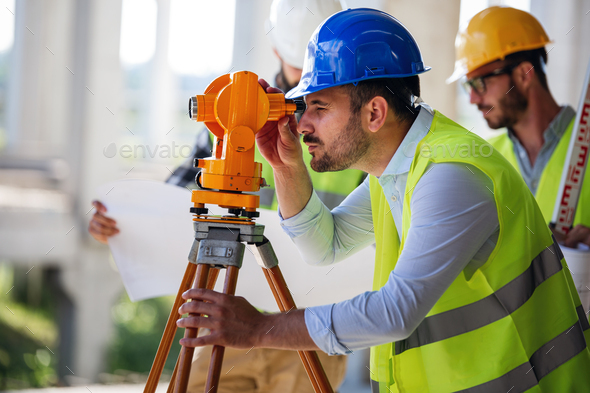 Engineer surveyor working with theodolite at construction site - Stock Photo - Images