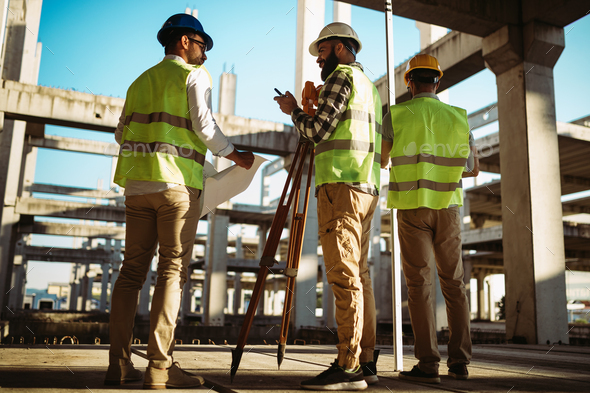 Business building teamwork people concept. Group of engineer with blueprint on construction site - Stock Photo - Images