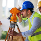 Engineer surveyor working with theodolite at construction site - PhotoDune Item for Sale