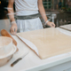 A man prepares an apple strudel for sale. Prepares the dough - PhotoDune Item for Sale
