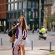 Young beautiful woman with backpack posing at camera - PhotoDune Item for Sale