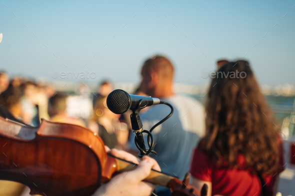 Retro microphone for outdoor concert party - Stock Photo - Images