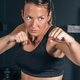Woman training hard boxing in the gym - PhotoDune Item for Sale