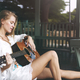 Beautiful singer songwriter with her guitar - PhotoDune Item for Sale