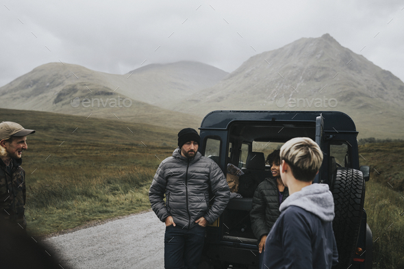 Friends on a road trip in the Highlands - Stock Photo - Images