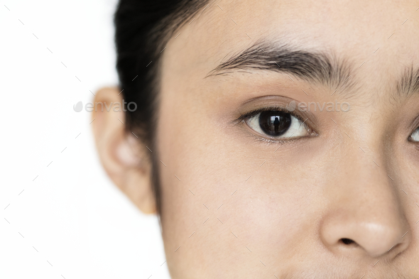 Closeup of Young Asian girl portrait isolated focused on eyes - Stock Photo - Images