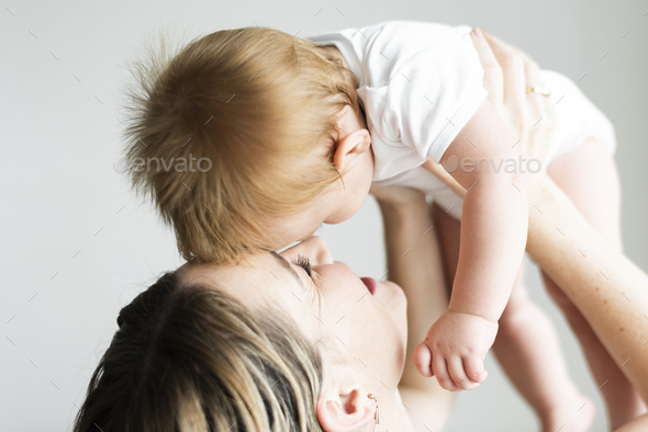 Mom playing with her baby - Stock Photo - Images