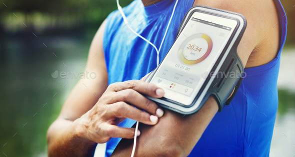 Man Running Tracker Armband Outdoors Concept - Stock Photo - Images