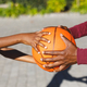 Midsection of african american father and son holding basketball together in garden - PhotoDune Item for Sale