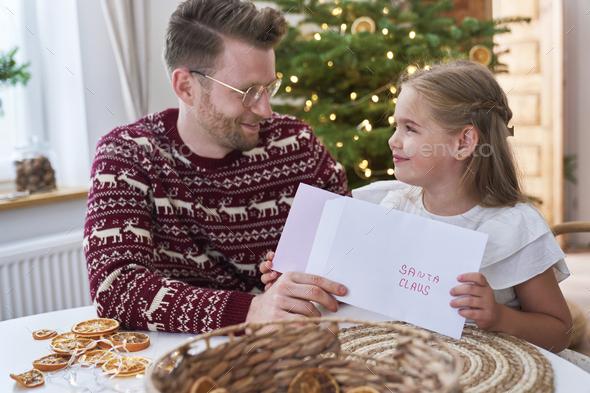 Little girl sending letter to Santa Claus - Stock Photo - Images