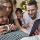 Family using smartphone during the Christmas - PhotoDune Item for Sale