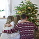 Family looking on Christmas tree - PhotoDune Item for Sale