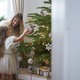 Little girl decorating the Christmas tree with mum - PhotoDune Item for Sale