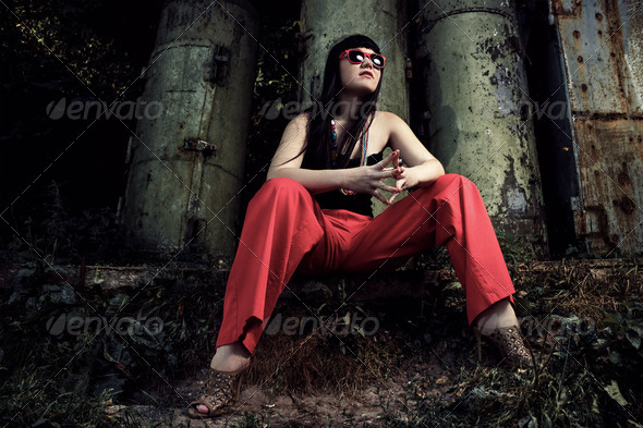 Girl In Red Pants And Glasses Over Industrial Background - Stock Photo - Images