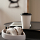 Close up of heasphones and takeaway cup on a table - PhotoDune Item for Sale