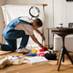 Young white man wearing overall working on craft rug at home - PhotoDune Item for Sale