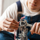 Young white man working with sewing machine indoors - PhotoDune Item for Sale