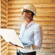 Civil engineer in safety cap working with laptop in building - PhotoDune Item for Sale