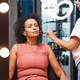 Delighted curly haired female being in beauty salon - PhotoDune Item for Sale