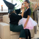 Young female in black witch attire applying makeup on eyes of little girl - PhotoDune Item for Sale