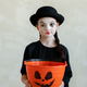 Girl with halloween makeup asking for treats while looking at you - PhotoDune Item for Sale