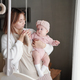 Young careful mother looking at her adorable baby daughter - PhotoDune Item for Sale