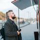 Portrait of man choosing fast food in food truck in the street. Meal, food industry and streetfood - PhotoDune Item for Sale