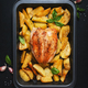 Baked chicken breast with golden potatoes in baking dish on dark background, top view - PhotoDune Item for Sale