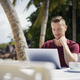 Man working on laptop on beach - PhotoDune Item for Sale