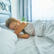 Little girl sleeping on a big and cozy bed white linen in the afternoon at home - PhotoDune Item for Sale