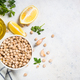 Chickpeas in white bowl at light kitchen table - PhotoDune Item for Sale