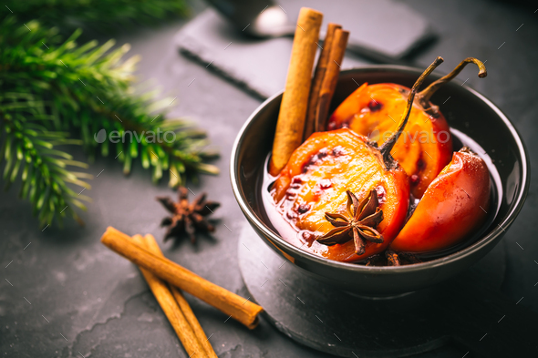 Christmas dessert - flamed tamarillo in hot wine punch with cinnamon and anise - Stock Photo - Images